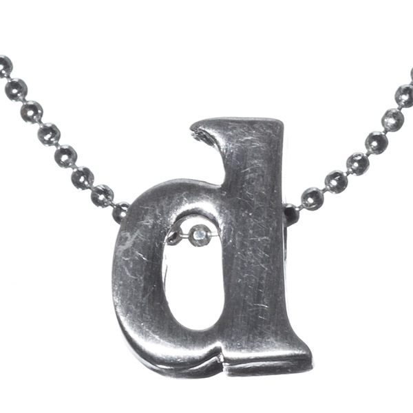 """16"""" small silver tone chain necklace with a 1/2"""" silver tone """"d"""" initial. Comes on a card with the inscription reading """"Wherever you are, whatever you do, whoever you are with, keep it close to your heart."""""""