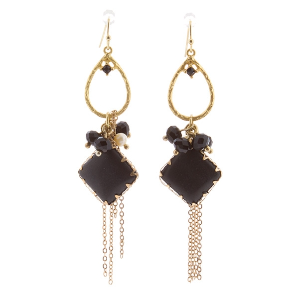 3 inch handmade matte gold tone earrings with a teardrop shaped ring and a dangling diamond shaped black stone with assorted beaded cluster and chain fringe