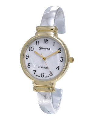Bright silver hinged cuff watch with a contrasting gold rimmed face. Black numerals and golden hands complete this classic look, which is well, timeless!