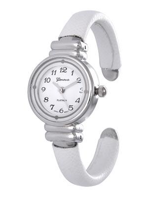 White Faux Skin Petite Women&#39s or Children&#39s Watch w/Polished Silver Tone Watch Head. White Dial. Black Numbers. 3 Polished Silver Tone Hands. (Watch Head is approx. 1.23 in L x 0.88 in W, 0.58 in Diameter)