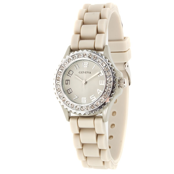 Petite beige silicone watch with crystal rhinestones surrounding the face. Stainless steel back and measures approximately 1 inch in diameter.