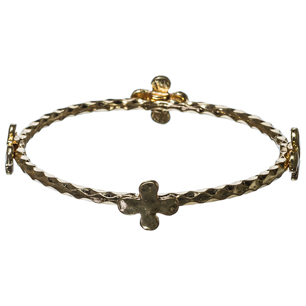 Antique gold tone hammered metal bangle bracelet with the rounded cross emblems.