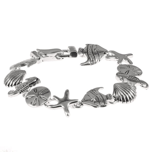 "7 1/2"" around silver tone charm bracelet featuring swimming fish and sea shells."