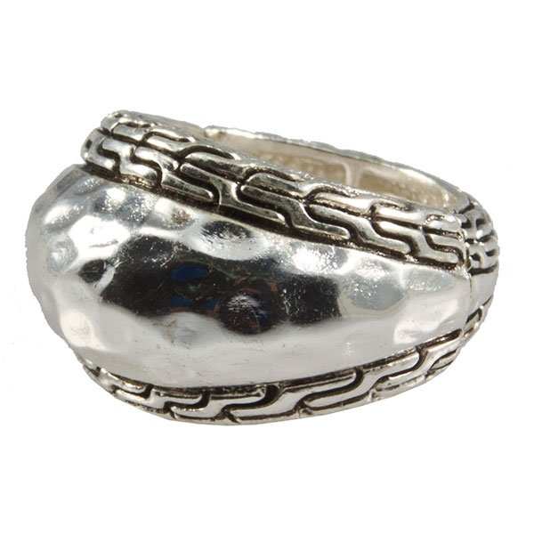 Silver tone stretch band ring with small battle meander symbols in bas relief, topped with a hammered silver tone, elongated centerpiece.